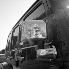 untitled (kaumpphoto) Tags: rolleiflex 120 tlr ilford bw black white street urban city reflection selfportrait car minneapolis rearviewmirror chrome handle door
