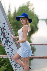 Old bridge portrait (piotr_szymanek) Tags: ania aniaz woman young skinny portrait outdoor face eyesoncamera hat blonde longhair hand legs mini skirt bridge water river 20f 1k 5k 50f 100f 10k 20k
