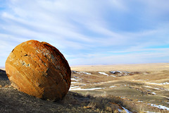 Round Red Rock (Bradley East Photography) Tags: coulee red rock redrock alberta canada southernalberta nature horizontal focus orange sedimentaryrock sediment sedimentary sky cloud skies clouds blue snow valley canyon grass rural farm scenic scene northamerica north america