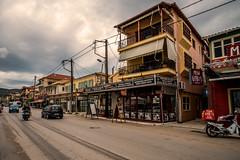 Downtown... (Dafydd Penguin) Tags: town city urban street road shops building island isle ionian greece lefkas levkas car people scene leica m10 21mm super elmar f34