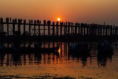 Sunset Over U Bein Bridge, Mandalay Myanmar (AdamCohn) Tags: adamcohn amarapura burma mandalay myanmar taungthamanlake ubeinbridge dusk goldenhour silhouette streetphotographystreetphotographer sunset wwwadamcohncom ဦးပိန်တံတား explored inexplore explore