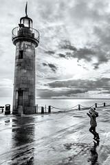 La petite fille près du phare de Cancale (Mirarmor) Tags: monochrome noir et blanc phare mer personnage bretagne ciel nuages pluie