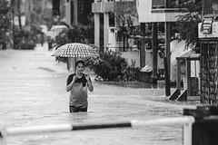 Flood. (Andy @ Pang Ket Vui ( shootx2 )) Tags: tawau sabah flood flooding going home smoking wet raining heavy