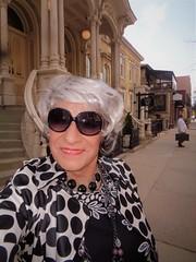 Traveling Incognito (Laurette Victoria) Tags: raincoat sunglasses necklace silver woman laurette milwaukee downtown