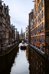 The Essence of Amsterdam (Top KM) Tags: ifttt 500px street canal city amsterdam boat houses netherlands urban travel building holland town europe the old exterior architecture capital cities streets architectural european culture history historic church famous