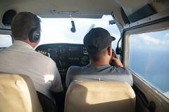 Belize From Above (peterkelly) Tags: digital canon 6d northamerica gadventures mayandiscovery belize cayecaulker hat cockpit plane airplane aerialphotography aerialphotos seat window caribbeansea pilot passenger