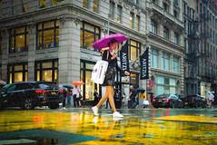 The New Yorkers - Rain (François Escriva) Tags: street streetphotography us usa nyc ny new york people candid olympus omd photo rue sun light woman colors sidewalk manhattan broadway yellow purple buildings rain raining wet asian bag umbrella