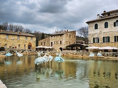 Bagno Vignoni (ekelly80) Tags: italy tuscany april2019 spring countryside bagnovignoni thermalpool hotspring bath art artinstallation water view thesecretgarden davidedall'osso cloudy moody sky dresses blue