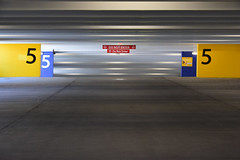 Level 5 (James_D_Images) Tags: parkingstructure parkade parkinggarage empty concrete structure beams walls signs 5 numbers donotenter lights lines perspective