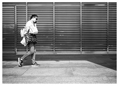 Oblivious (Dave Button) Tags: canarywharf london bw black white grey gray mono monochrome street fuji fujifilm xe2s xe2 27mm border