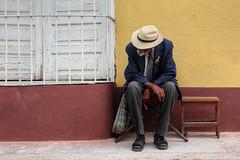 The man with no name (FX-1988) Tags: street photography portrait cuban cuba trinidad latino america yellow wall facade urban old man sit