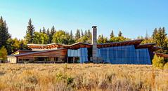 Craig Thomas Visitor Center, Grand Teton National Park, Wyoming (lhboudreau) Tags: grandteton grandtetonnationalpark grandtetons tetons park national craigthomasvisitorcenter visitorcenter moose wyoming outdoor tree trees grass wood building architecture sky