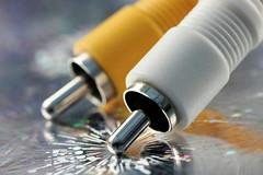 Macro Mondays...Theme...Plugs and Jacks. (Sue Armsby) Tags: macromondays macro metal sparkle shine electrical plugsandjacks yellow white 7dwf freetheme armsbysue