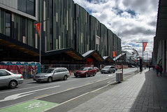 Flags of Flying (Jocey K) Tags: hoytscinemaandfoodemporiumconstruction colombostreet cars flags sky clouds trees earthquakerebuild architecture building christchurch newzealand cbd city
