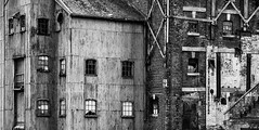 The Beauty of Derelict Buildings (photofitzp) Tags: bw blackandwhite gloucester history corrugated decay derelict docks ruins timber