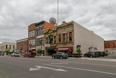 Buildings — Napoleon, Ohio (Pythaglio) Tags: buildings structures historic napoleon ohio unitedstatesofamerica commercial ornate twostory brick metal 11windows italianate latevictorian eclectic storefronts altered awnings street clouds cars henrycounty