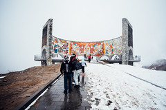 Russia–Georgia Friendship Monument (ewitsoe) Tags: 20mm city d750 europe georgia nikon spring street tbilisi travel people urban monument russiangeorgianmilitaryroad kazbegi pass snow halfcircle massive outdors landscape visit cold lowclouds mountains mountain