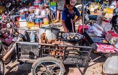 2019 - Cambodia - Sihanoukville - Phsar Leu Market - 2 of 25 (Ted's photos - Returns late November) Tags: 2019 cambodia cropped nikon nikond750 nikonfx tedmcgrath tedsphotos vignetting phsarleumarket sihanoukvillephsarleumarket phsarleumarketsihanoukville sihanoukvillecambodia sihanoukville market 1people boy lad youngboy male cart wheel