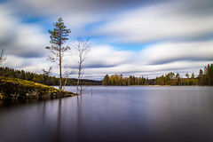 Lakescape (mabuli90) Tags: lake finland spring clouds sky water tree forest rock