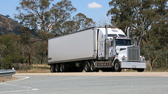 White on White (2 of 3) (Jungle Jack Movements (ferroequinologist)) Tags: sar damorange refrigerated transport maddens harden kenworth k200 t909 ct t610 bowning hume highway nsw new south wales australia hp horsepower big rig haul haulage freight cabover trucker drive carry delivery bulk lorry hgv wagon road nose semi trailer deliver cargo interstate articulated vehicle load freighter ship move roll motor engine power teamster truck tractor prime mover diesel injected driver cab cabin loud rumble beast wheel exhaust double b grunt