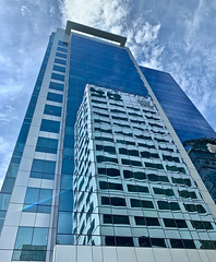 Building One, Building Two (ahockley) Tags: blue city lookingup onemainplace oregon pdx portland reflection shotoniphone shotoniphonexs sky