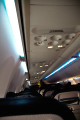 Overhead 7 (LongInt57) Tags: airplane aircraft jet cabin seats lights ceiling people passengers white blue black seatac seattle washington usa