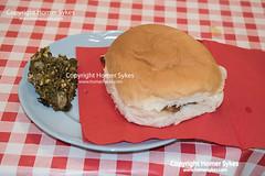 DOCK PUDDING TRADITIONAL MIDGLEY SPAW SUNDAY YORKSHIRE (Homer Sykes) Tags: dockpuddingfoodlocalcookingcookcommunitycentrebacodockpudding food local cooking cook communitycentre baconbuttie sandwich spawsunday spasunday midgley yorkshire 2019 2010s welldressing folkcustom folklore uk britain british england english village homemade