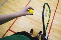 0404 Courtney holds a ball and racquet on the racquetball court (12mm)