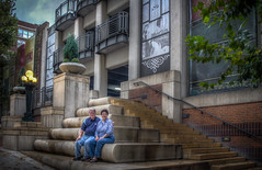 Sharon and I sitting on the steps of the parking garage of the Kansas City, Missouri Central Branch Public Library (donnieking1811) Tags: missouri kansascity kansascitypubliclibrary centralbranch parkinggarage steps books lights lamposts architecture building hdr canon 60d lightroom photomatixpro people