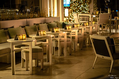 Balcony Dining (yarnim) Tags: thephoenician luxurycollection spg marriott bonvoy sony a7 a7m3 a7iii sel85f18 85mm primelens prime arizona phoenix resort hotel lowlight night ambiance dining tables christmas lights balcony