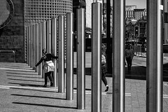 Weaving in and out (Nikonsnapper) Tags: olympus em1 leica summilux 25mm f14 cardiff poles street shadows playing bw