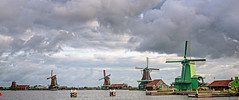 Windmills of Zaanse Schans (Brett of Binnshire) Tags: historicalsite zaandam netherlands locationrecorded on1raw manipulations museum 2391 zaanseschans northholland clouds river water architecture windmill weather