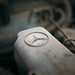 Mercedes star on the engine of a vintage car