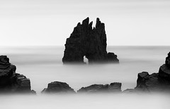 Guardian of the Sea (One_Penny) Tags: canon6d photography spain landscape seascape sea ocean atlantic water nature coast shore blur rocks stones black white blackandwhite bnw bw longexposure minimal symmetry blurredwater abstract