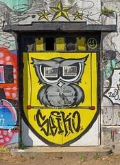 The Blind Owl (TablinumCarlson) Tags: europa europe österreich austria wien vienna tür door eule owl unregierbar seika streetart mural gelb yellow leica dlux dlux6 gate tor blindowl grafitti art vogel bird