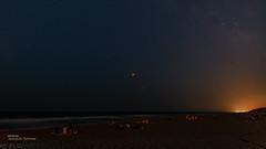 Night of eclipse (Oddiseis) Tags: moon eclipse mars planets stars beach elsaler valencia valenciancommunity spain night nightscape nocturnal sea water waves light lightpollution people sigma2014art sand