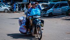 2019 - Cambodia - Sihanoukville - Phsar Leu Market (Ted's photos - Returns late November) Tags: 2019 cambodia cropped nikon nikond750 nikonfx tedmcgrath tedsphotos vignetting motorcycle streetscene street shadow phsarleumarket phsarleumarketsihanoukville sihanoukvillecambodia sihanoukville ballcap