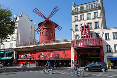 Sunny Paris. (Oleg.A) Tags: france sunny building montmartre moulinrouge street people city outdoor retro midday town red old sun summer house theatre paris avenue art îledefrance blue sky square tourists shadow style cityscape noon prospect theater