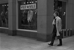 Suit Sale (Jovan Jimenez) Tags: canon eos rebel t2 ef 40mm f28 stm kodak trix 400 35mm film suit sale plustek opticfilm 8200i ai man streetphotography black white gray bw monochrome monochromatic grain