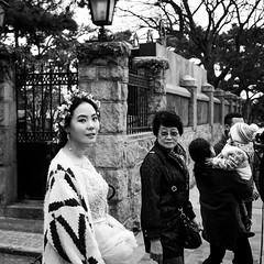 Family escort (Go-tea 郭天) Tags: qingdao shandong républiquepopulairedechine badaguan wedding pitctures photo shoot shooting bride young woman lady old women mother escort escorded dress future flowers crown family love baby child group walk walking together spot eyes beautiful beauty portrait street urban city outside outdoor people candid bw bnw black white blackwhite blackandwhite monochrome naturallight natural light asia asian china chinese canon eos 100d 24mm prime
