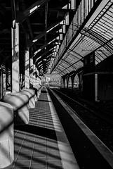 shadowplay (ro_ha_becker) Tags: leicaclanalog leitzsummicron2040mm film analogue monochrome schwarzweiss zwartwit biancoenero blancetnoir blackandwhite blancoynegro oldenburg bahnsteig bahngeleise bahnhof railway railwaystation shadows schatten silhouette meinfilmlab
