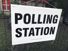 Polling Station sign stock photo image (DPP Business and Tax) Tags: polling station sign uk school white black polls poll vote ey eu european election elections referendum government democracy prime minister london local primary