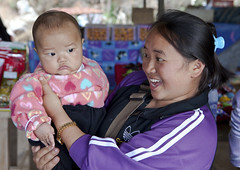 Hmong Mother showing off her baby (klauslang99) Tags: klauslang streetphotography travel hmong thailand mother child baby proud love