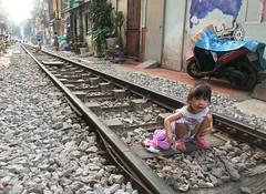 Girl on Train Street (cowyeow) Tags: hanoi vietnam asia asian street urban city people candid girl littlegirl young train tracks trainstreet weird dangerous travel pretty portrait composition