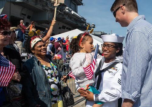 A Sailor holds her daughter after the ship arrived at Norfolk Naval Station.