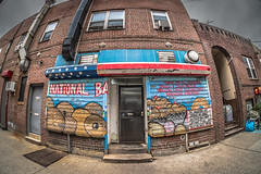 Bagels and Things (JMS2) Tags: storefront bagel cakes fisheye street building bronx shopping