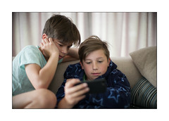 attracted to the online world... [Saturday morning already] (Istvan Penzes) Tags: penzes leicamptyp240 manualfocus leicanoctiluxf10e60 availablelight lucas thomas child portrait