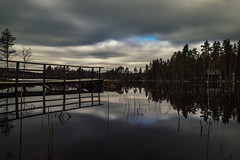 Lakescape III (mabuli90) Tags: finland lake water forest tree woods grass dock pier cabin clouds sky