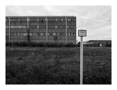 170930_172236_oly-PEN-f_heusden-zolder_de schacht_5/9 (A Is To B As B Is To C) Tags: aistobasbistoc b belgië belgium heusdenzolder limburg mijnwerkerslaan koolmijn magazijnen brick brickwork steel steelframe sign water drainpipes vertical land bw blackwhite blackandwhite monochrome olympus penf deschacht