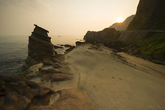 A Particular Rock Faces the Rising Sun (milton sun) Tags: rock nanyarockformations northeastcoastnationalscenicarea newtaipeicity taiwan seascape wave ocean shore seaside coast pacificocean landscape outdoor clouds sky water mountain rollinghills sea sand beach cliff nature sunrise morning 南雅奇岩